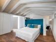 Grosses modernes lichtdurchflutetes Zimmer im Divina Suites Hotel Boutique