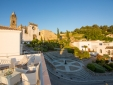 Panoramic views from the top terrace with the 16 century church and castle ruins in the background